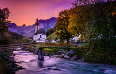 Autumnal sunset (gregor158) Tags: sunset mountains mountain river church autumn fall glow red ramsau germany berchtesgaden sky trees tree leaves rocks water bridge landscape