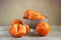 Sweet Mandarin Oranges (Through Serena's Lens) Tags: lookingcloseonfriday stilllifewithfruit orange juicy mandarinorange bowl dof closeup fruit food tabletop canoneos6dmarkii texture stilllife