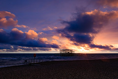 Brighton West Pier at Sunset (Rhisiart ap Cymru) Tags: canoneos sunset pier canon clouds thecityofbrightonandhove unitedkingdom coastline silhouette ruins sussex cloud eastsussex horizon autumn shingle england brighton brightonandhove brightonpier sea lifesaver canoneos2000d beach water sun brightonbeach sky sunlight brightonwestpier shore englishchannel coast gb greatbritain