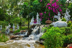Small waterfall and sculptures depicting a story from the Ramayana in Muang Boran (Ancient City) in Samut Phrakan, Thailand (UweBKK (α 77 on )) Tags: muang mueang boran muangboran ancient city siam open air museum park garden recreation education culture cultural samutphrakan samut phrakan province bangkok thailand southeast asia sony alpha 77 slt dslr water waterfall flow sculpture story ramayana