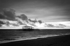 Brighton West Pier at Sunset (Rhisiart ap Cymru) Tags: canoneos sunset pier canon clouds thecityofbrightonandhove unitedkingdom coastline silhouette ruins sussex cloud eastsussex horizon autumn shingle england brighton blackwhite brightonpier sea canoneos2000d beach monochrome water brightonandhove sun brightonbeach sky sunlight brightonwestpier shore englishchannel coast gb greatbritain
