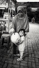 Jakarta (-Faisal Aljunied - !!) Tags: faisalaljunied streetphotography indonesia jakarta grandmother kid children balloons blackandwhitestreetphotography