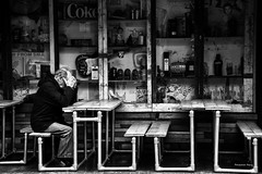 """Despair"" Maybe !! (Pensioner Percy, very slow at the moment) Tags: dispair bw manchester brexit street contemplation acdsee d7200 nikon england mood dingy coffee mind cafe tables monochrome nikon18140mm man head city seats coke salford jackdanial ashtray face blackandwhite"