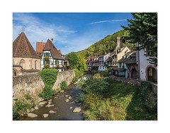 Kaysersberg (Peter Jaspers) Tags: frompeterj© 2019 olympus zuiko omd em10 1240mm28 kaysersberg france french hautrhin alsace grandest halftimberedhouses colors sky river routeduvin weiss riviere
