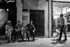 Friendship (Roi.C) Tags: monochrome black bw people outside outdoor candid ligh europe nikon d5300 nikkor photography photo digital shot street city human humans persons picture image camera interesting talking 18140mm man road composition white portrait italy september 2018 old face sitting town urban blackandwhite smile oldman absoluteblackandwhite standing streetphotography cityphotography urbanphotography travelphotography