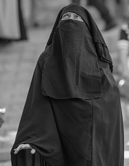 Out of the depths have I called Thee, O LORD. (ybiberman) Tags: israel jerusalem oldcity alquds muslimquarter woman hijab niqab worry bothered candid streetphotography portrait documentary bw palm