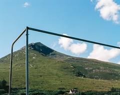 Goalposts under Slievemore, Achill (adambermingham) Tags: mayo dugort achill pentax6x7 mediumformat ektar100 slievemore ireland goalposts goals