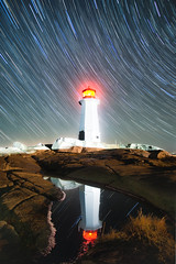 Reflecting on Stars (bluegreenorange) Tags: lighthouse lighthousetrail peggyscove night stars peggyscovelighthouse nightphotography startrails astrophotography peggyspointlighthouse ns novascotia canada
