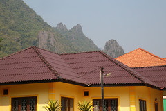 Yellow Home (peterkelly) Tags: digital canon 6d asia southeastasia indochinaencompassed gadventures laos vangvieng yellow house home mountain forest roof limestone village