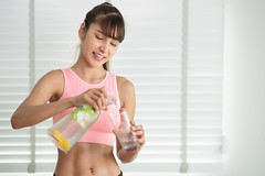 Asian girl drink a  infused detox water after finish exercise in fitness gym (I love landscape) Tags: sport fitness fit bottle juice vitamins refresh refreshing flavor healthcare slim mineral health jar sweet herb vegan fruit thai asia asian woman lady girl peppermint mint lemon orange apple fresh healthy background drink water lemonade natural refreshment green organic beverage freshness detox vegetarian food lime homemade diet cocktail spring ice