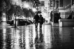 Rainy Night (CoolMcFlash) Tags: street streetphotography vienna rain wet umbrella people candid bw blackandwhite bnw blackwhite canon eos 60d tamron a007 2470 reflection rainy strase wien regen nass regenschirm personen sw schwarzweis spiegelung fotografie photography night nacht