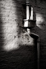 Pipes (MauScaMe) Tags: drain pipes blackandwhite wall manualfocus shadows light