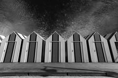 Les cabines de bain (Jacques Isner) Tags: yport cabines cabanon cabane normandie noiretblanc ciel cloud plage pentax pentaxart pentaxflickraward pentaxk1 samyang14mm samyang flickrunitedaward ombre terrasse jacquesisner