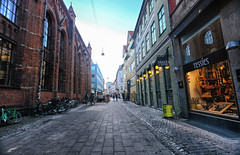 Shops in Copenhagen, Denmark (` Toshio ') Tags: toshio copenhagen denmark europe european danish scandinavia europeanunion store street restaurant fujixt2 xt2 dusk church cathedral bike bicycle people city bistro