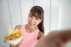 Asian girl take a selfie with clean food after exercise in fitness gym (I love landscape) Tags: dessert slim vitamin cleanfood juice home dieting selfie photo camera delicious meal health sport fitness fit exercise food thai asia asian banana fresh granola healthy lifestyle clean organic diet vegetarian fruit woman breakfast yogurt sweet hand nutrition eating honey bowl background girl white detox wooden muesli fruits smoothie smoothies berry