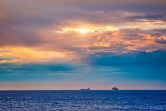 Waiting at Sea (David Hamments) Tags: freighters wa backbeach manualfocus sunset bunbury crepuscularrays