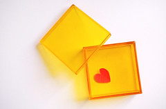 Red Heart. Yellow Box. (LeftCoastKenny) Tags: utata ironphotographer red heart sticker yellow plastic box crossprocessed utata:description=hide utata:project=ip291