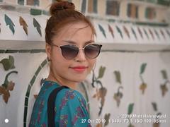 2019-02b Wat Arun (22a) (Matt Hahnewald) Tags: matthahnewaldphotography facingtheworld qualityphoto people head face eyes sunglasses mouth lipstick expression lookingcamera eyecontact hair hairstyle topbun consensual beauty style oriental touristattraction temple photoshoot location bangkok thailand asia asian vietnamese person one female young woman women portraiture background nikond610 nikkorafs85mmf18g 85mm 4x3ratio resized 1200x900pixels horizontal street portrait closeup headshot seveneighthsview sidewaysglance outdoor colour posingcamera feminine beautiful attractive happy lovely stunning fabulous porcelain watarun faience pagoda topknot bun tourist tourism smilingmouthclosed grace naturallight
