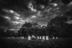 waiting for the sun (Chrisnaton) Tags: england london stjamespark blackandwhite clouds autumn deckchairs park relax