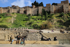 Youngsters hanging out at the old Roman Theatre (B℮n) Tags: málaga fuentedelastresgracias roundabout paseodelparque malaka malaga fuentedelastresninfas fountain lafarolapromenade promenade alcazaba fortress moorish history monument roman theatre oldestcity costadelsol spain spanje andalusia andalucia vista oranges palmtrees mediterranean center street motor walls openmuseum hill outerwalls palace ancient citadels holiday sightseeing park universityofmalaga universidaddemálaga catedraldelaencarnacióndemálaga jardinesdepedroluisalonso motorcyclist traffic road fountainfilledgardens medieval overlooking sea lush rotonde fontein tamronsp2470mm moon laalcazaba youngsters 50faves topf50