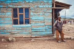 Qué Vendrá (u c c r o w) Tags: arusha tanzania portrait urban urbanlife street streetlife blue frame wood wooden africa african maasai window