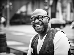 friendly.real.estate.agent (grizzleur) Tags: street portrait posed asked friendly nice great handsome smile teeth white black blackwhite bw mono monochrome olympus olylove olympusm45mmf18 omd olympusomdem10mkii glasses vest