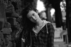 Diana Brick 28 Mono (TheseusPhoto) Tags: girl female woman pose portrait portraiture model modeling artportrait artistic fineartportrait fineart eyes beautiful sexy lovely glamour street city brick bricks look leather plaid fashion bokeh hair