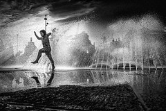 Girl playing at the fountain at Stachus (Karlsplatz) in Munich - Germany (Patrik S.) Tags: münchen munich germany reflection sky mirror sony a7m3 a7iii photography day pond house bayern deutschland bavaria urban travel living city people life de development area ngc dark friends good time historic famous bw blackandwhite girl playing water fountain black white