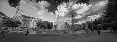 Fountain and column (Мaistora) Tags: monument memorial column statue history historic war ww2 politics blocks division camps fountain square park panorama composite assembly 7shot bw bnw blackandwhite mono monochrome film analog analogue print paper silver grain contrast perspective distortion wideangle ultrawide vienna austria leica dlux typ109 edit process postprocess photpshop topaz nik silverfx