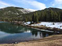 Forgetmenot Pond (annkelliott) Tags: alberta canada swofcalgary forgetmenotpond manmade landscape scenery lake pond water reflections trees forest mountain snow outdoor fall autumn 24october2019 nikon p900 nikonp900 coolpix annkelliott anneelliott ©anneelliott2019 ©allrightsreserved