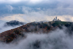 The st primoz church in  a misty autmun morning (Palnick) Tags: architecture autumn blue catholicism chapel christianity church europe european alps fog forest gorenjska hill leaf meadow mountain multi colored nature outdoors religion scenics sky slovenia summer sunset tourism tranquility travel tree village water aerial alpine attraction background beautiful building colorful exterior field foliage green jamnik landmark landscape view wallpaper agricultural kamnik trekking