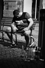 He who sleeps (auqanaj) Tags: 20190822bis20190913 kodakgold200 nikonafnikkor85118d nikonf100 analog cewescan film asleep man street monochrome blackandwhite schwarzweis bench spirits alcohol booze drunk trash garbage bottles night nightout tired sleep sleeping outoffocus dazed