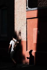 Light gap (Guido Klumpe) Tags: candid street streetphotographer streetphotography strase hannover hanover germany deutschland city stadt streetphotographde unposed streetshot gebäude architecture architektur building perspektive perspective color farbe kontrast contrast gegenlicht shadow schatten silhouette minimal minimalism minimalistisch simple reduced mann men gentleman outdoor drausen outside himmel sky