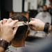 Creative barber cutting hair with scissors