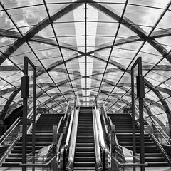Choose your escalator (frank_w_aus_l) Tags: noiretblanc black blackandwhite bnw building bw hamburg lines architecture arches escalator stairs symmetry sky city d850 nikkor 2470