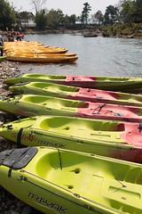 Nam Song River Kayaks (peterkelly) Tags: digital canon 6d asia southeastasia indochinaencompassed gadventures laos vangvieng namsongriver kayaks kayak water river green pink orange triyak