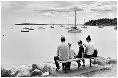 I'd rather be sailing (halifaxlight) Tags: canada novascotia southshore chester family couple boys boats atanchor moored sea clouds island bench sitting looking cell phone mobile bw