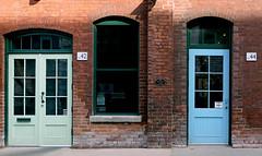 No 42 and 44. (Bernard Spragg) Tags: doors entrance exit lumix toronto compactcameras trave two twin brick cco