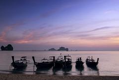 Tonsai Beach (Bernd Schunack) Tags: railay tonsai beach longtail boat sunset fantastic light rocks cliffs water ocean andaman sea clouds silhouette paradise krabi sun horizon thailand panasonic lumix gx9