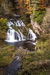 Photo of fine art, long exposure, autumn colours of the Falls of Dess as evening descends on the Dee Valley. Kincardine O'Neil, Aberdeenshire, Scotland.