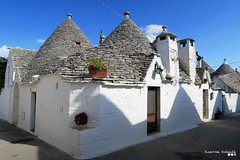 "A ""Trulli"" Neighborhood... (Κώστας Καϊσίδης) Tags: trulli alberobello puglia italy bari apuglianarchitecture architecture homes houses town seasidetown trullihouses traditionalvillage traditional trullineighborhood neighborhood sky shadows stonehouse stoneroof kostaskaisidis canon ngc traveltheme travel outdoor old october oldstory apulia"