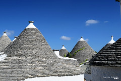 The Trulli of Alberobello... (Κώστας Καϊσίδης) Tags: trulli alberobello italy bari architecture homes houses town seaside traditional village neighborhood sky stonehouse canon travel theme outdoor old october apulia oldstory apulianarchitecture trullihouses traditionalvillage stoneroofs kostaskaisidis trullo southernitaly