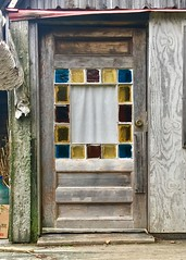 Weathered door (DjD-567) Tags: red yellow blue stainedglass door tinyhouse maine weathered