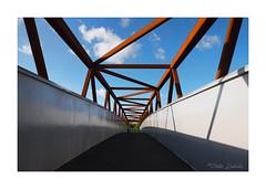 Footbridge (PeteZab) Tags: footbridge bridge red blue bluesky clouds geometry lines steel structure path peterzabulis nottingham uk