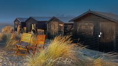 Walberswick Beach sunrise (Aron Radford Photography) Tags: yellow walberswick suffolk southwold beach coast sunrise dawn golden hour huts grass dune sand frost chairs deck