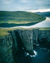 Surreal Cliff (Fabian Fortmann) Tags: faroe färöer cliffs landscape north nordic tiny people sea lake sunset