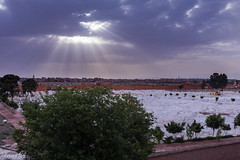 A break in the clouds (Irina1010) Tags: sky clouds rays fanning perspective city marrakesh cemetery morocco canon
