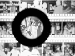 DaveBurnettJohnnyMartyriPhoneNegatives (Johnny Martyr) Tags: dave burnett daveburnett photographer photojournalist documentary washingtondc leicastore leicastoredc bwfilm bw film 35mm wechoosetogotothemoon galleryopening apolloxi negatives filmnegatives loupe magnification image kodak