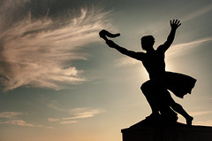 Statue Passing On The Torch - Gellert Hill (Eksworks) Tags: d7000 nikon torch statue silhouette shadow bichrom budapest street art gellert monument sky clouds blue sun
