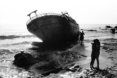 ... (johnny walker no label) Tags: bw seascapes people film fomma400 corfu nikonfg shipwreck